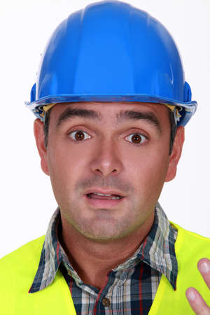 Builder with confused look on his face photo
