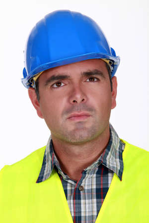 Puzzled construction worker photo