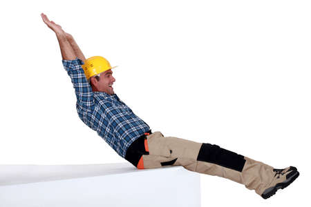 flannel: Tradesman stretching his body Stock Photo
