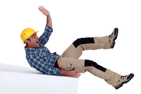 Construction worker falling over photo