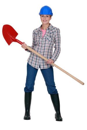 obrero: Tradeswoman sosteniendo una pala