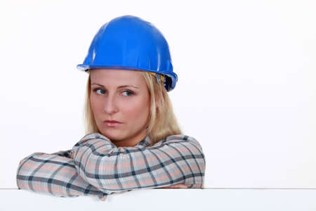 disengage: Serious woman in a hard hat