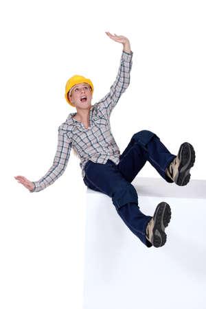 bending down: craftswoman falling down