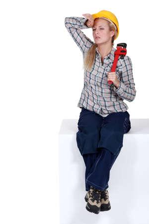 break from work: Tired female plumber