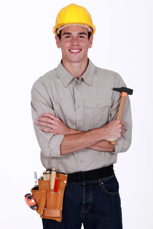 practiced: happy craftsman holding a hammer