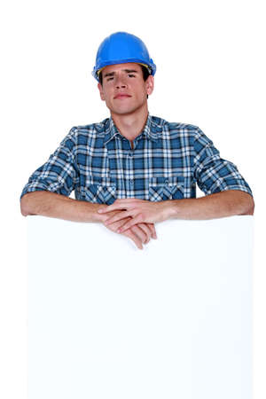 Skeptical workman with a blank board photo