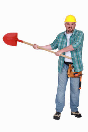 incensed: angry craftsman holding a shovel