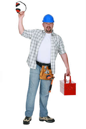 bout: Mason with earflaps and toolbox in hand