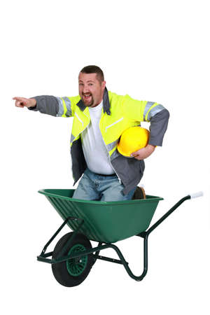trussing: craftsman sitting in a wheelbarrow