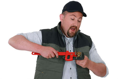 man nuts: Plumber with an adjustable wrench
