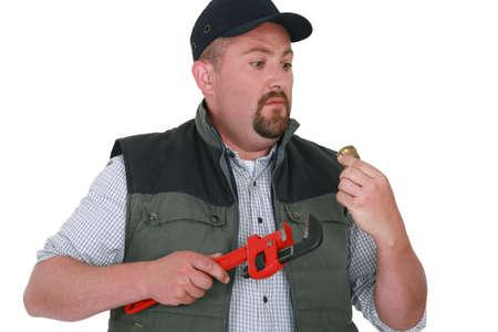 apprehensive: Apprehensive handyman staring at an object