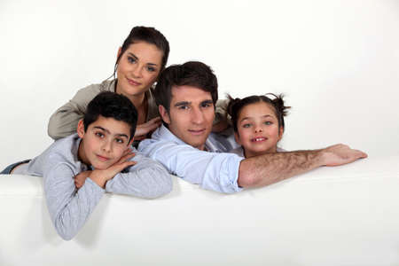 Familia sentado en el sof� photo