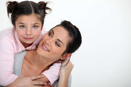 fond of children: Young girl hugging her mother