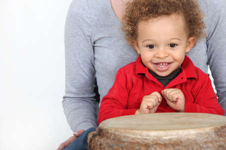 bongo drum: Little boy sat by bongo drum