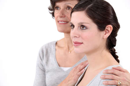 younger: Mother putting her hands on her daughter Stock Photo