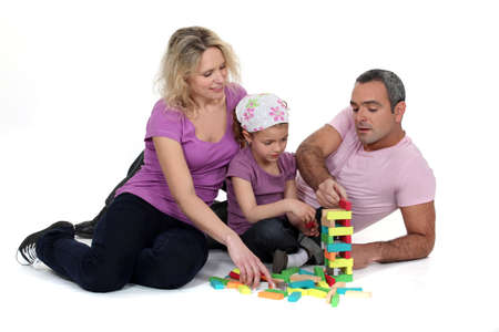 indian family: Family playing with building blocks