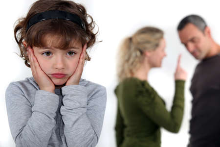 Little girl upset by parents arguing photo