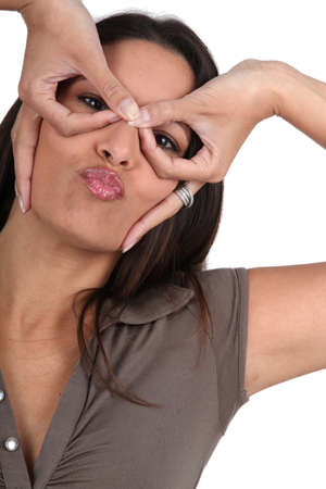 Woman pulling silly face photo