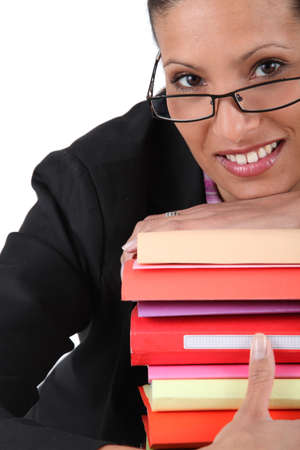 employee holding a stack of files Stock Photo - 22029243