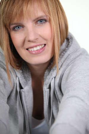 hooded top: Blond woman wearing hooded top