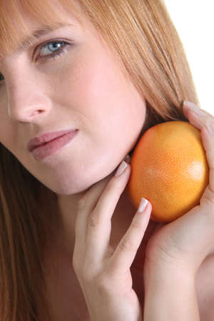 Woman holding a grapefruit Stock Photo - 22031600