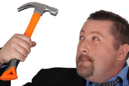 seething: Businessman holding hammer