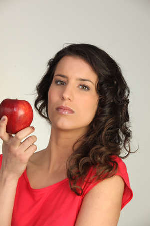 weight reduction plan: beautiful young woman holding an apple Stock Photo