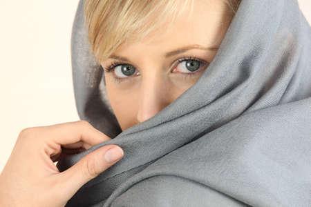 close-up of a woman face wearing a headkerchief photo