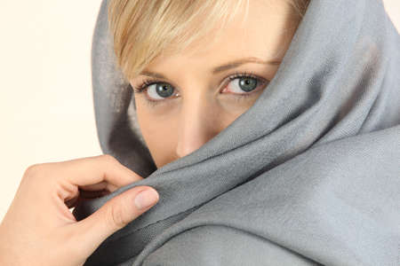 apprehensive: close-up of a woman face wearing a headkerchief