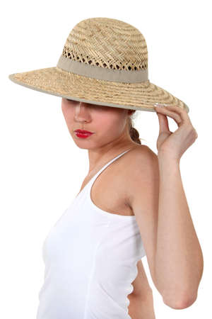 brim: Woman hiding her face under a wide-brimmed hat Stock Photo