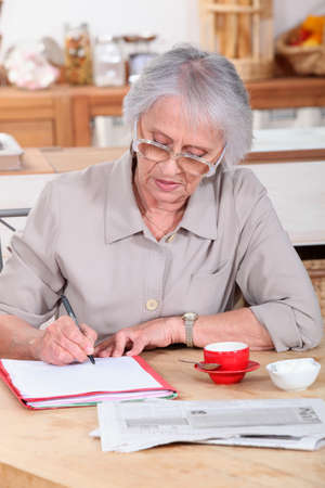 Woman filling out forms photo