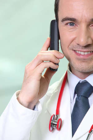Doctor giving good news over the telephone photo