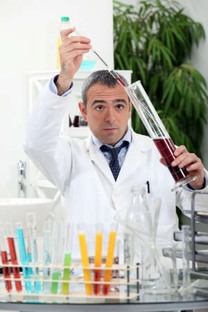 precipitate: a scientist doing experiments in his laboratory