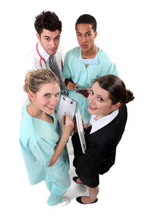 huddling: Hospital staff huddling