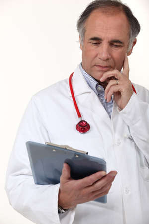 Doctor studying his patients results photo