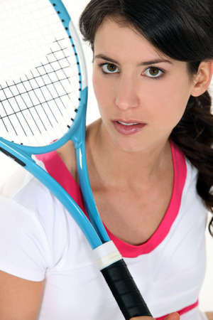 emotionless: Woman holding a tennis racket Stock Photo