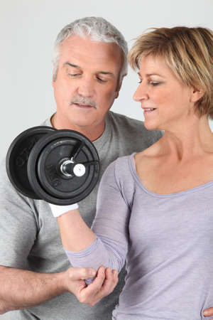hand grip: Woman lifting weights Stock Photo