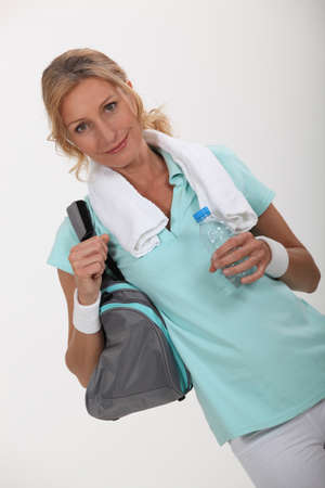 40 50: Woman with sports bag over shoulder Stock Photo