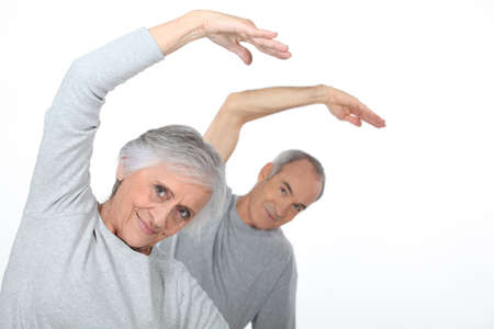Elderly couple warming up photo