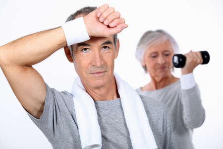 aerobic exercise: senior couple doing fitness