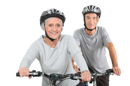 55 to 60: Elderly couple cycling