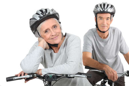 third age: Senior couple on a bicycle