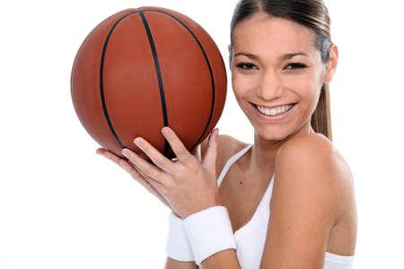 Brunette holding basketball photo