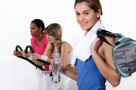 female trio in fitness center photo