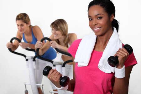 Three women at the gym  Stock Photo