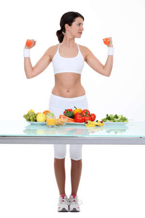 gut: Woman with dumbbells and healthy food
