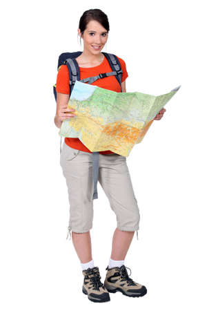 Female backpacker studying a map photo
