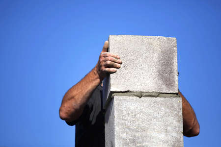 workingman: Builder creating a chimney stack Stock Photo