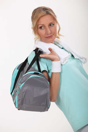 45 50 years: Woman with sports bag over shoulder Stock Photo
