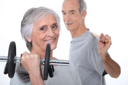 dumb: Grey-haired couple lifting weights Stock Photo